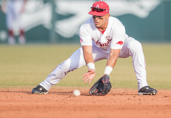 Arkansas infielder Michael Bernal (3) fields a ball during a baseball game between Arkansas and Central Michigan on 2-19-16.   (Alan Jamison, Nate Allen Sports Service)