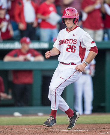 Arkansas outfielder Jack Benninghoff (26) scores a run during a baseball game between Arkansas and Central Michigan on 2-19-16.   (Alan Jamison, Nate Allen Sports Service)