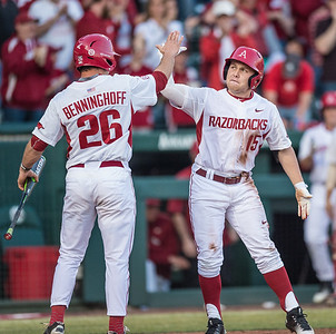 Arkansas outfielder Jake Arledge (15) celebrates a run with Jack Benninghoff during a baseball game between Arkansas and Central Michigan on 2-19-16.   (Alan Jamison, Nate Allen Sports Service)