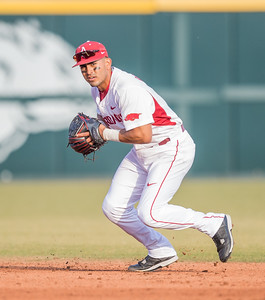 Arkansas infielder Michael Bernal (3) prepares to throw to first during a baseball game between Arkansas and Central Michigan on 2-19-16.   (Alan Jamison, Nate Allen Sports Service)