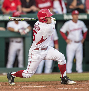 Arkansas outfielder Jake Arledge (15) hits during a baseball game between Arkansas and Central Michigan on 2-19-16.   (Alan Jamison, Nate Allen Sports Service)