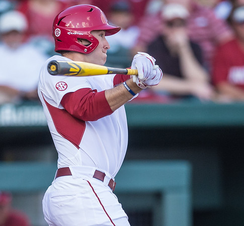 Arkansas outfielder Austin Catron (19) at bat during a baseball game between Arkansas and Central Michigan on 2-19-16.   (Alan Jamison, Nate Allen Sports Service)