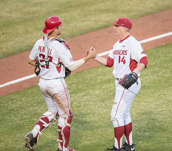 Arkansas catcher Tucker Pennell (27) celebrates the Razorback win with Arkansas pitcher Doug Willey (14) during a baseball game between Arkansas and Central Michigan on 2-19-16.   (Alan Jamison, Nate Allen Sports Service)