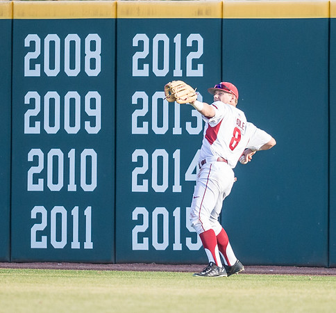 Arkansas outfielder Eric Cole (8) fields a ball during a baseball game between Arkansas and Central Michigan on 2-19-16.   (Alan Jamison, Nate Allen Sports Service)