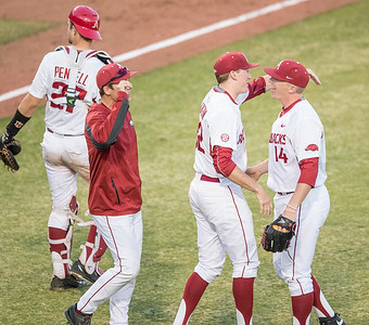 Arkansas pitcher Zach Jackson (32) hugs Arkansas pitcher Doug Willey (14) to celebrate the Razorback win during a baseball game between Arkansas and Central Michigan on 2-19-16.   (Alan Jamison, Nate Allen Sports Service)