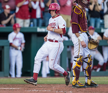 Arkansas outfielder Jack Benninghoff (26) scores during a baseball game between Arkansas and Central Michigan on 2-19-16.   (Alan Jamison, Nate Allen Sports Service)