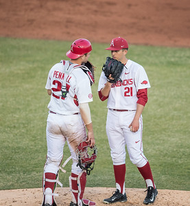 Arkansas catcher Tucker Pennell (27) talks to Kacey Murphy on the mound during a baseball game between Arkansas and Central Michigan on 2-19-16.   (Alan Jamison, Nate Allen Sports Service)