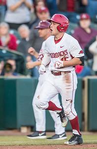 Arkansas outfielder Jake Arledge (15) runs home during a baseball game between Arkansas and Central Michigan on 2-19-16.   (Alan Jamison, Nate Allen Sports Service)