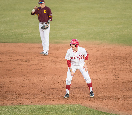 Arkansas outfielder Austin Catron (19) takes a lead toward third base during a baseball game between Arkansas and Central Michigan on 2-19-16.   (Alan Jamison, Nate Allen Sports Service)