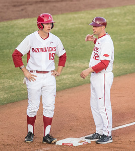 Arkansas outfielder Austin Catron (19) receives instruction from Razorback assistant coach Tony Vitello during a baseball game between Arkansas and Central Michigan on 2-19-16.   (Alan Jamison, Nate Allen Sports Service)