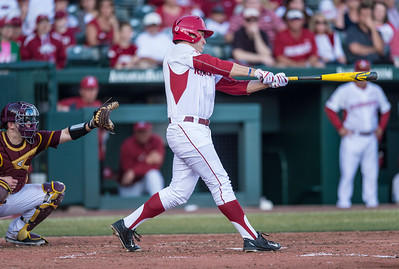 Arkansas outfielder Austin Catron (19) hits during a baseball game between Arkansas and Central Michigan on 2-19-16.   (Alan Jamison, Nate Allen Sports Service)