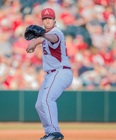 Arkansas pitcher Dominic Taccolini (25) throws to first base on a pick-off move during a baseball game between Arkansas and Central Michigan on 2-19-16.   (Alan Jamison, Nate Allen Sports Service)