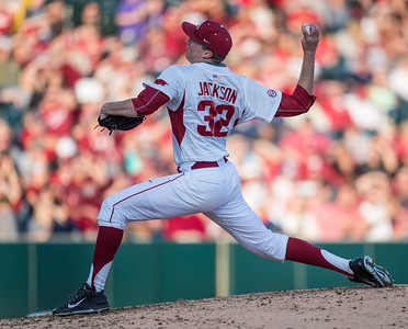 Arkansas pitcher Zach Jackson (32) pitches in relief during a baseball game between Arkansas and Central Michigan on 2-19-16.   (Alan Jamison, Nate Allen Sports Service)