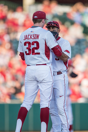 Arkansas pitcher Zach Jackson (32) meets on the mound with Arkansas infielder Michael Bernal (3) during a baseball game between Arkansas and Central Michigan on 2-19-16.   (Alan Jamison, Nate Allen Sports Service)