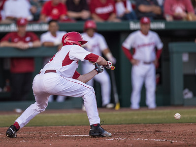 Arkansas outfielder Clark Eagan (9) bunts Arkansas outfielder Clark Eagan (9) during a baseball game between Arkansas and Central Michigan on 2-19-16.   (Alan Jamison, Nate Allen Sports Service)