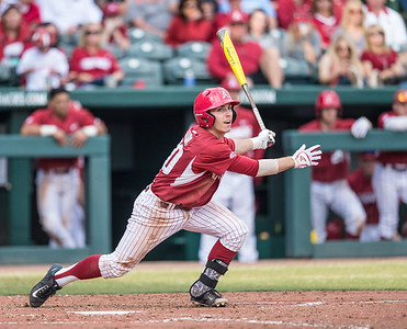 Arkansas catcher Carson Shaddy (20) takes off for first base during a baseball game between Arkansas and Central Michigan on 2-20-16.   (Alan Jamison, Nate Allen Sports Service)