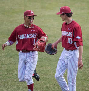 Arkansas infielder Rick Nomura (1) congratulates Blaine Knight on his pitching during a baseball game between Arkansas and Central Michigan on 2-20-16.   (Alan Jamison, Nate Allen Sports Service)