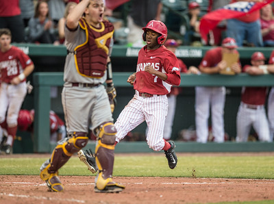 Arkansas outfielder Darien Simms (7) scores in the eighth inning during a baseball game between Arkansas and Central Michigan on 2-20-16.   (Alan Jamison, Nate Allen Sports Service)