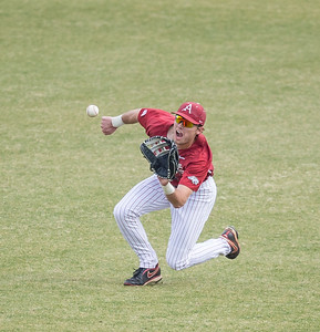 Arkansas outfielder Clark Eagan (9) with a nice fielding play during a baseball game between Arkansas and Central Michigan on 2-20-16.   (Alan Jamison, Nate Allen Sports Service)