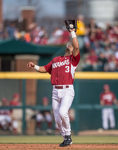 Arkansas infielder Michael Bernal (3) catches a fly ball during a baseball game between Arkansas and Central Michigan on 2-20-16.   (Alan Jamison, Nate Allen Sports Service)