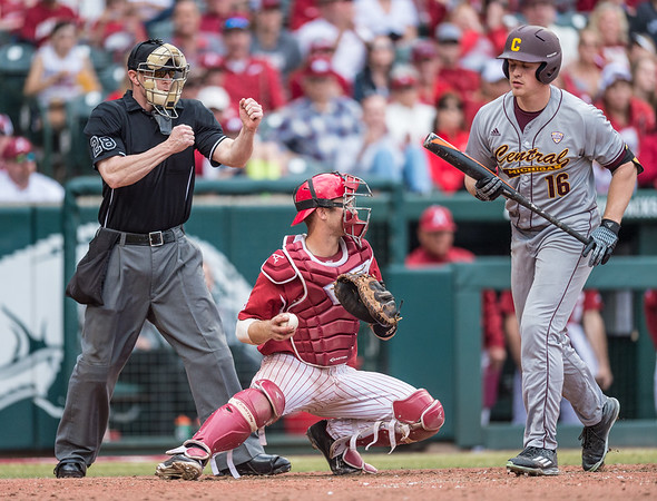 After Arkansas pitcher Zach Jackson (32) enters the game, the umpire starts doing this during a baseball game between Arkansas and Central Michigan on 2-20-16.   (Alan Jamison, Nate Allen Sports Service)