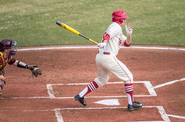 Arkansas outfielder Austin Catron (19) at bat during a baseball game between Arkansas and Central Michigan on 2-21-16.   (Alan Jamison, Nate Allen Sports Service)