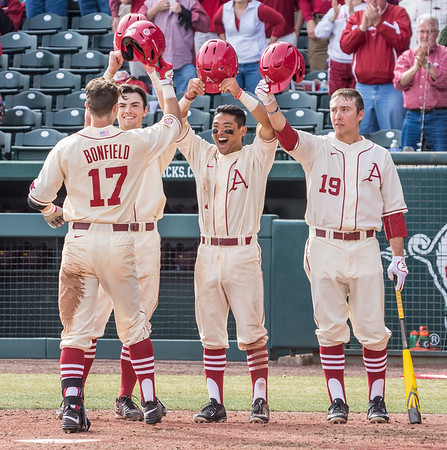 Arkansas outfielder Luke Bonfield (17) celebrates his first career home run with Clark Eagan, Rick Nomura, and Austin Catron during a baseball game between Arkansas and Central Michigan on 2-21-16.   (Alan Jamison, Nate Allen Sports Service)
