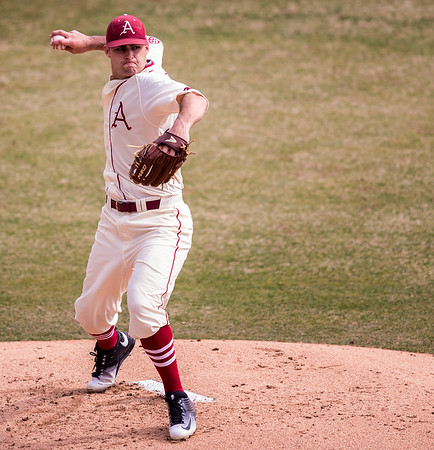 Arkansas pitcher Keaton McKinney (11) throws to first base  during a baseball game between Arkansas and Central Michigan on 2-21-16.   (Alan Jamison, Nate Allen Sports Service)