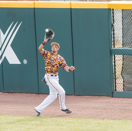 Central Michigan outfielder Logan Regnier (13) catches a ball at the warning track during a baseball game between Arkansas and Central Michigan on 2-21-16.   (Alan Jamison, Nate Allen Sports Service)