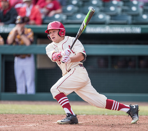 Arkansas outfielder Jake Arledge (15) hits during a baseball game between Arkansas and Central Michigan on 2-21-16.   (Alan Jamison, Nate Allen Sports Service)