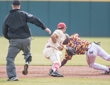 Arkansas infielder Michael Bernal (3) tags out Central Michigan infielder Zach McKinstry (8) during a baseball game between Arkansas and Central Michigan on 2-21-16.   (Alan Jamison, Nate Allen Sports Service)