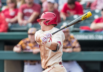 Arkansas outfielder Eric Cole (8) at bat during a baseball game between Arkansas and Central Michigan on 2-21-16.   (Alan Jamison, Nate Allen Sports Service)