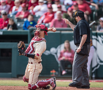 Arkansas catcher Tucker Pennell (27) throws the ball back to the pitcher during a baseball game between Arkansas and Central Michigan on 2-21-16.   (Alan Jamison, Nate Allen Sports Service)