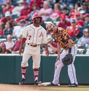 Arkansas outfielder Darien Simms (7) comes in to pinch run for Arkansas infielder Cullen Gassaway (29) during a baseball game between Arkansas and Central Michigan on 2-21-16.   (Alan Jamison, Nate Allen Sports Service)