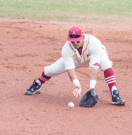 Arkansas infielder Michael Bernal (3) fields a ball during a baseball game between Arkansas and Central Michigan on 2-21-16.   (Alan Jamison, Nate Allen Sports Service)