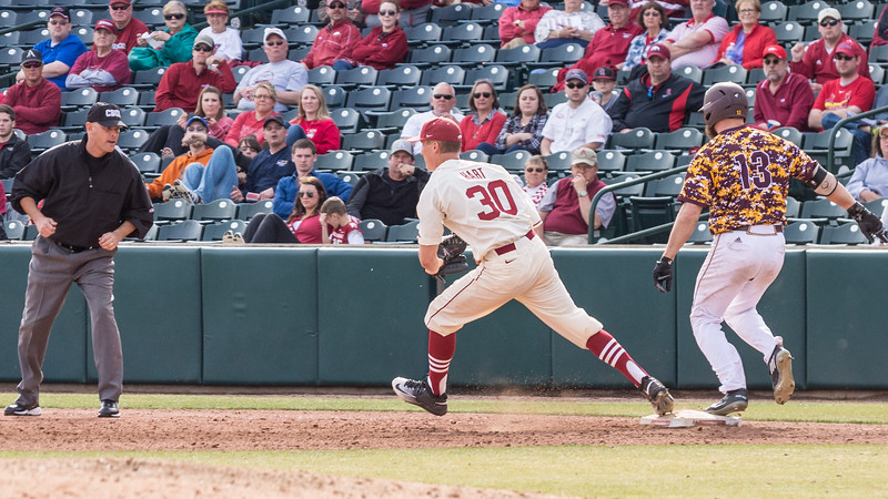 Arkansas pitcher Hunter Hart (30) beats Central Michigan outfielder Logan Regnier (13) to the plate for an out during a baseball game between Arkansas and Central Michigan on 2-21-16.   (Alan Jamison, Nate Allen Sports Service)
