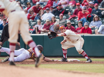 Arkansas infielder Cullen Gassaway (29) with a tag out attempt at first base during a baseball game between Arkansas and Central Michigan on 2-21-16.   (Alan Jamison, Nate Allen Sports Service)