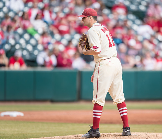 Arkansas pitcher Keaton McKinney (11) gets a sign during a baseball game between Arkansas and Central Michigan on 2-21-16.   (Alan Jamison, Nate Allen Sports Service)