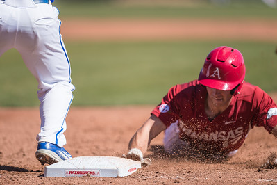 Arkansas outfielder Luke Bonfield (17) beats the tag back at first base during a baseball game between Arkansas and Eastern Illinois on 3-5-16.   (Alan Jamison, Nate Allen Sports Service)
