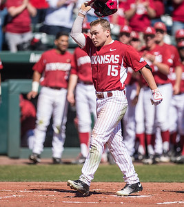 Arkansas outfielder Jake Arledge (15) celebrates a home run during a baseball game between Arkansas and Eastern Illinois on 3-5-16.   (Alan Jamison, Nate Allen Sports Service)