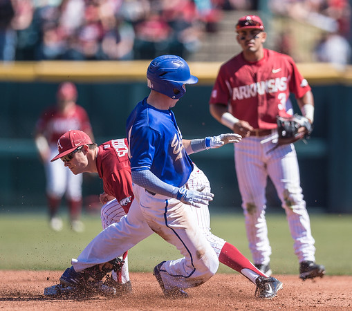 Arkansas infielder Cody Scroggins (5) tags the EIU player at second base during a baseball game between Arkansas and Eastern Illinois on 3-5-16.   (Alan Jamison, Nate Allen Sports Service)