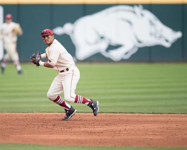 Arkansas infielder Michael Bernal (3) fields a ball during a baseball game between Arkansas and Western Illinois on 3-5-16.   (Alan Jamison, Nate Allen Sports Service)