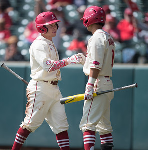 Arkansas infielder Rick Nomura (1) congratulates Jake Arledge on a run during a baseball game between Arkansas and Western Illinois on 3-5-16.   (Alan Jamison, Nate Allen Sports Service)