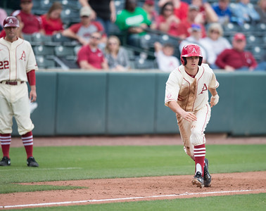 Arkansas infielder Cody Scroggins (5) prepares to run home during a baseball game between Arkansas and Western Illinois on 3-5-16.   (Alan Jamison, Nate Allen Sports Service)