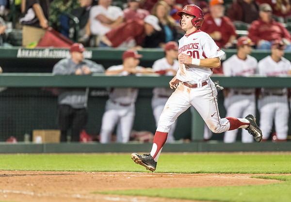 Arkansas catcher Carson Shaddy (20) scores during a baseball game between Arkansas and Grambling State on 3-15-2016.    (Alan Jamison, Nate Allen Sports Service)