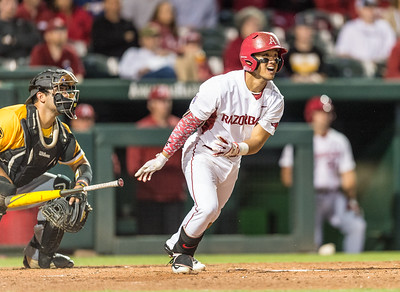 Arkansas infielder Rick Nomura (1) hits a home run during a baseball game between Arkansas and Grambling State on 3-15-2016.    (Alan Jamison, Nate Allen Sports Service)