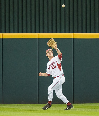 Arkansas outfielder Jack Benninghoff (26) catches a fly ball during a baseball game between Arkansas and Grambling State on 3-15-2016.    (Alan Jamison, Nate Allen Sports Service)