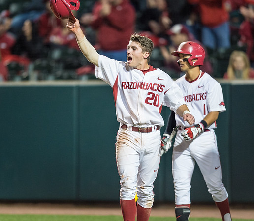 Arkansas catcher Carson Shaddy (20) celebrates a run during a baseball game between Arkansas and Auburn on 3-25-16.  (Alan Jamison, Nate Allen Sports Service)