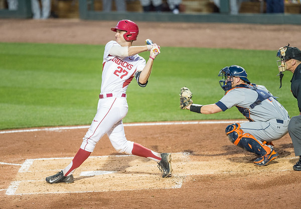 Arkansas catcher Tucker Pennell (27) bats during a baseball game between Arkansas and Auburn on 3-25-16.  (Alan Jamison, Nate Allen Sports Service)