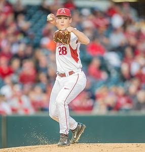 Arkansas pitcher James Teague (28) throws to first base during a baseball game between Arkansas and Auburn on 3-25-16.  (Alan Jamison, Nate Allen Sports Service)